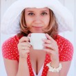 Young girl in red dress with cup of coffee — Foto Stock