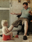 Child on potty play with father. Photo in old image style. — ストック写真
