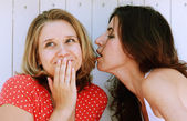 Two women whispering — Stock Photo
