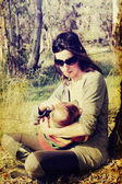 Beautiful young mother breastfeeding baby in sunny spring day. P — Stock Photo