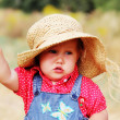 Beautiful girl in the hat on the meadow — Stock Photo