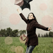 Young woman with umbrella. Photo in old color image style. — Stock Photo