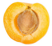 Apricot sectioned by knife — Stock Photo