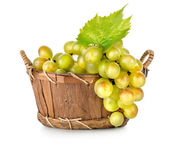 Grapes in a wooden basket isolated — Stock Photo