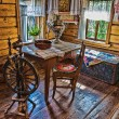 Stock Photo: Interior of Russilog hut with elements of old way of li