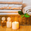 Spa with towels and candle - Stock Photo
