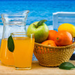 Orange juice in a glass on a table - Stock Photo