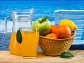 Orange juice in a glass on a table — Stock Photo