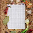 Notebook to write recipes with spices - Stock Photo