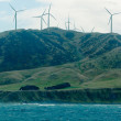 Stock Photo: Windfarm wind turbines in mountain terrain