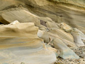 Sandstone sediment smoothed and rounded by water — Stock Photo