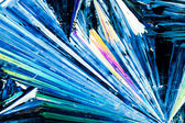 Benzoic acid crystals in polarized light — Stock Photo
