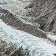 Climate change, melting glacier ice and sheer rock — Stock Photo