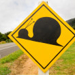 Fake attention Kauri Snail Crossing Road Sign - 图库照片