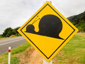 Fake attention Kauri Snail Crossing Road Sign — Stok fotoğraf
