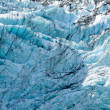 Blue glacier ice background texture pattern — Stock Photo