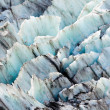 Blue glacier ice background texture pattern - Stock Photo