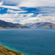 Blue surface of Lake Hawea, Central Otago, NZ - Foto de Stock