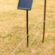 Stock Photo: Solar electric livestock fence charger and fencing