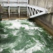 Stok fotoğraf: Hydro dam control weir with underneath discharge