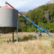 Stock Photo: Agricultural metal fodder fermenting silo storage