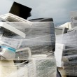 Shrink wrapped pile of electronics computer waste — Stock Photo