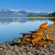 Stock Photo: Wooden deckchairs overlooking scenic Lake Laberge