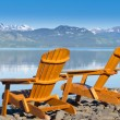 Royalty-Free Stock Photo: Wooden deckchairs overlooking scenic Lake Laberge