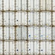 Stock Photo: Pattern of shipping container stack at depot