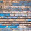 Grungy blue painted wood planks of exterior siding — Stock Photo