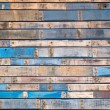 Grungy blue painted wood planks of exterior siding — Stock Photo #11716441
