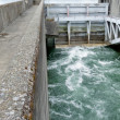 Foto Stock: Hydro dam control weir with underneath discharge