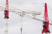 Two large steel construction cranes close together — Stock Photo