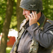 Nazi with mobile phone — Stock Photo
