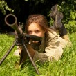 Girl with machinegun — Stock Photo