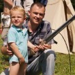 Kid and his father with sword — Stock Photo