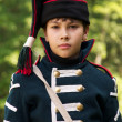 Kid in uniform arillerymen XIX century — Stock Photo