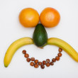 Face made of fruits - Stock Photo