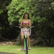 Girl riding her while text messaging - 