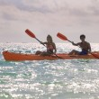 Stock Photo: Couple paddling their kayak