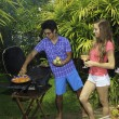 Couple having a barbecue — Stockfoto