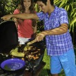 Couple having a barbecue — 图库照片