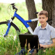 Teen in park with laptop — Stock Photo #11067759
