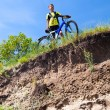 Boy on a bicycle near a cliff - Stock Photo