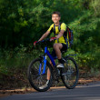 A teenager on a bicycle traveling in the woods — Stock Photo #11067817