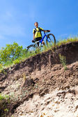 Boy on a bicycle near a cliff — Stock Photo