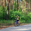 A teenager on a bicycle traveling in the forest — Stock Photo