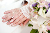 Hands of the groom and the bride — Стоковое фото