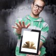 Digital library - Good Looking Smart Nerd Man With Tablet Comput - Foto Stock