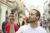 Man Take Photo With Mobile Phone On Street — Stock Photo